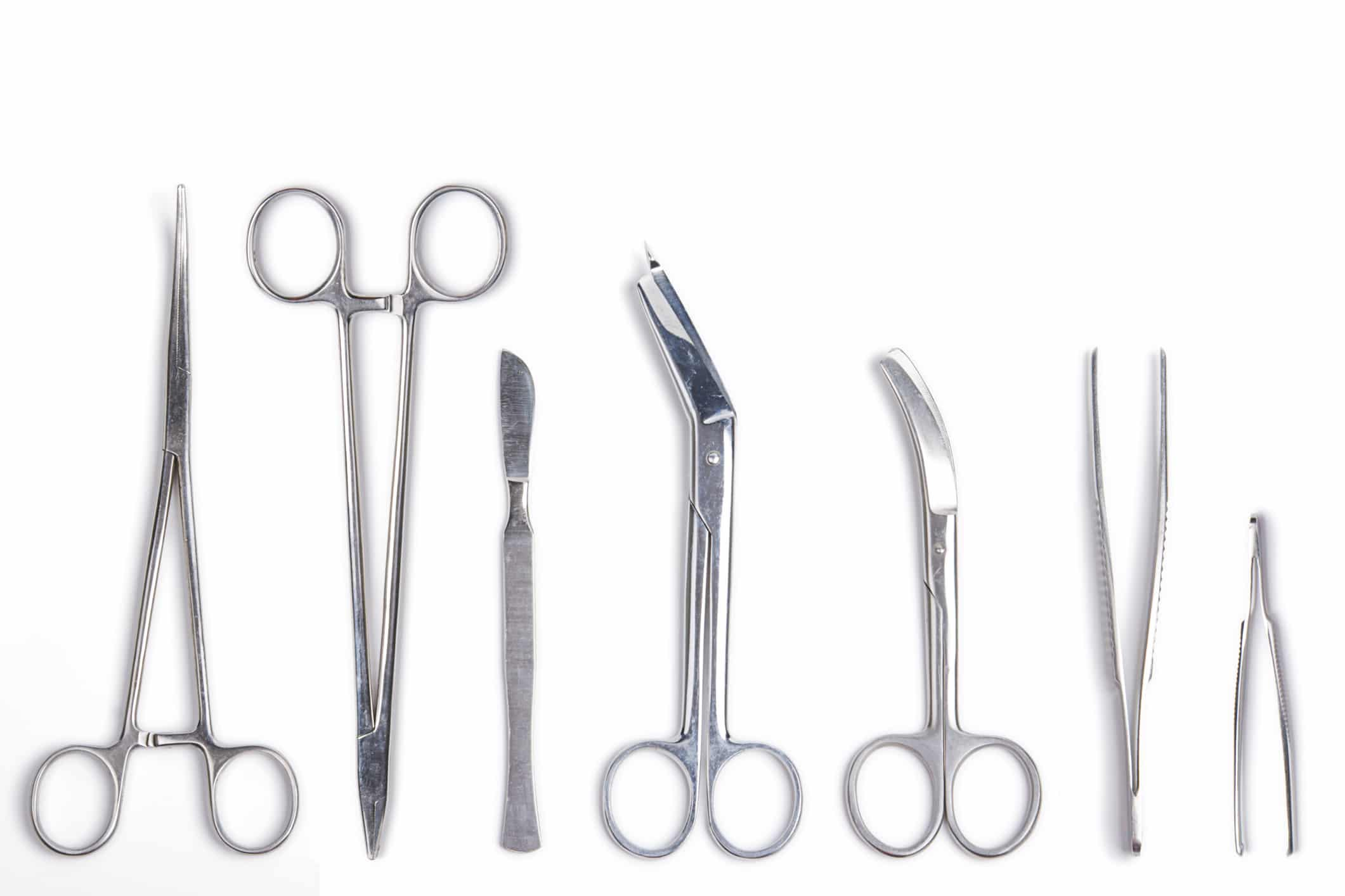 Surgeon tools - scalpel, forceps, clamps, scissors - isolated